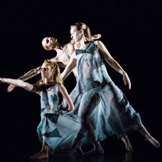 Three dancers performing onstage