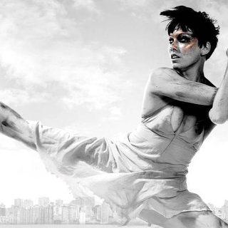 A female dancer in a split leap