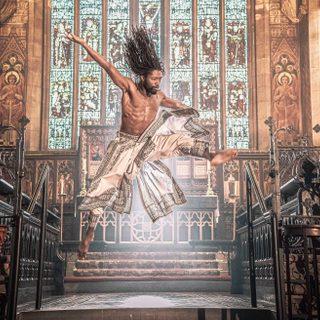 Akeim Toussaint Buck leaping in a Church